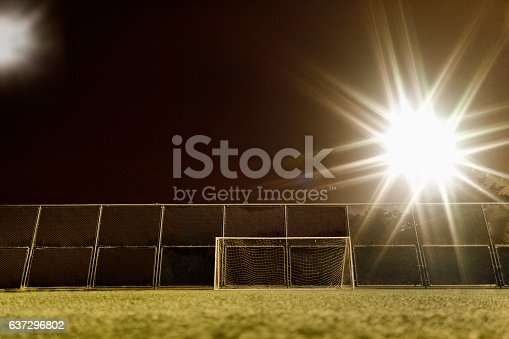 637297180 istock photo View of soccer field illuminated at night 637296802