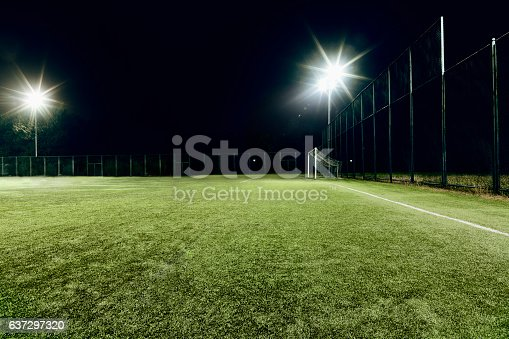 637297180 istock photo View of soccer field illuminated at night 637297320