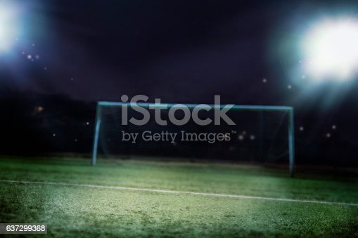 637297180 istock photo View of soccer field illuminated at night 637299368