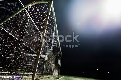 637297180 istock photo View of soccer field illuminated by stadium light at night 637299016