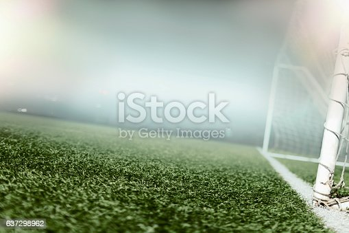 637297180 istock photo View of soccer field illuminated in hazy fog at night 637298962