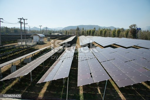 istock View of solar farm in sunlight with blue sky, dirty solar cell  array, green energy concept. 1029635420