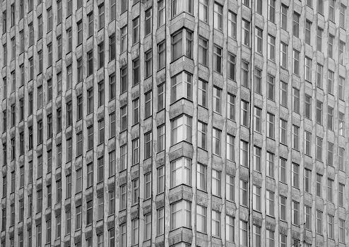 Old facades of brutalist soviet socialist buildings.