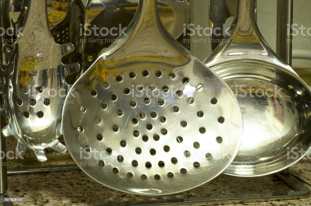 view of  spoons to serve soup stock photo