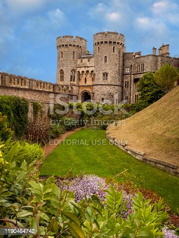 view along a lawn and gardens of the St George's Gate at  Windsor Castle, at Windsor England, in the county of Berkshire
