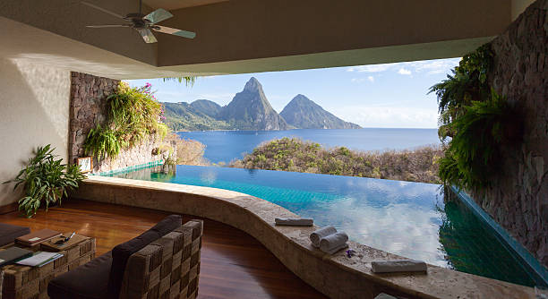 View of St. Lucian Twin Pitons from Jade Mountain The World Heritage Petit Piton framed by  beautiful infinity-pool. View from the famous resort Jade Mountain. infinity pool stock pictures, royalty-free photos & images
