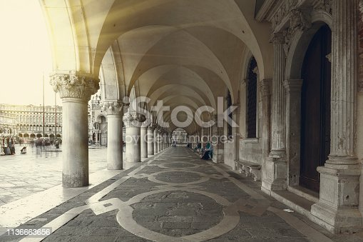 View of St Mark's square and the colonnade of Doge's Palace in Venice at sunset