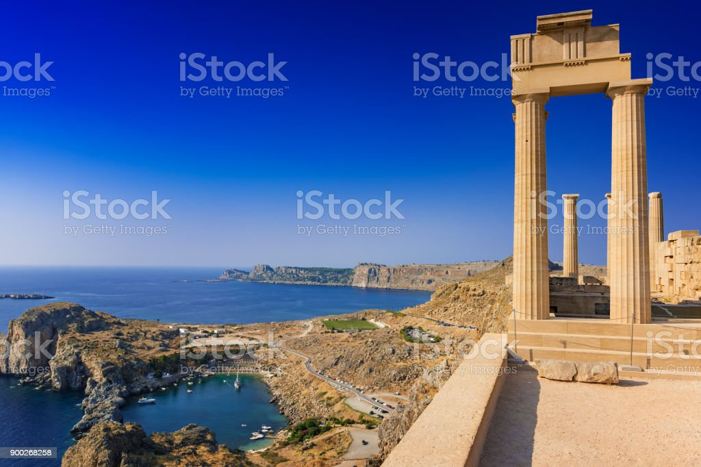 View of St. Paul´s bay and ancient temple of goddess Athena on acropolis of Lindos (Rhodes, Greece) stock photo