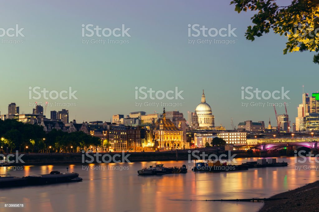View of St Pauls Cathedral and City of London at night stock photo