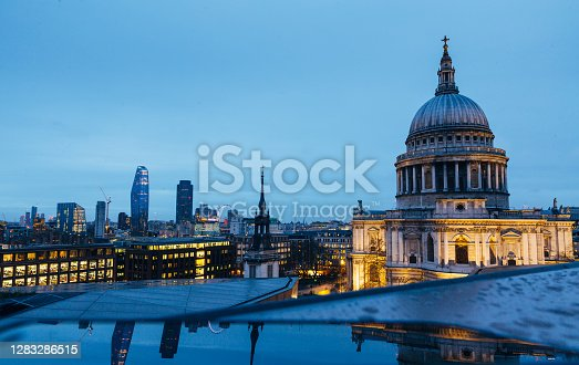 istock View of St. Pauls Cathedral and evening London cityscape during dusk on cloudy day 1283286515