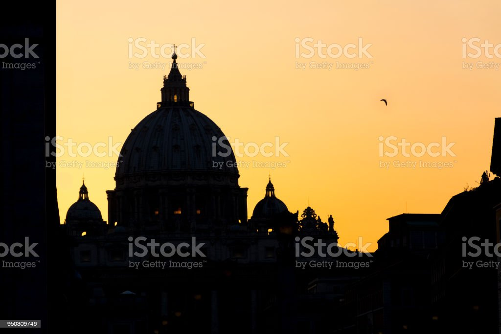 view of St. Peter's Basilica in Rome at sunset, Italy stock photo