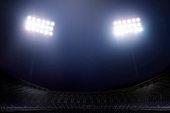 istock View of stadium lights at night 1165226936