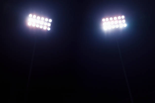 View of stadium lights at night stock photo