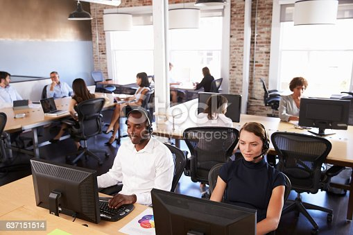 istock View Of Staff In Busy Customer Service Department 637151514