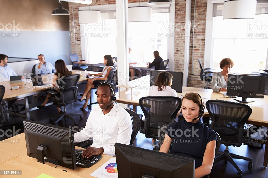 View Of Staff In Busy Customer Service Department stock photo
