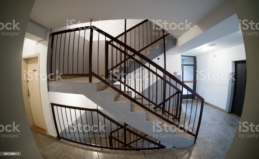 View of staircase hallway of residential building as seen through a peephole stock photo
