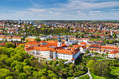 istock View of Strahov Monastery in Prague, Czech Republice. Red roofs and parks 865635282