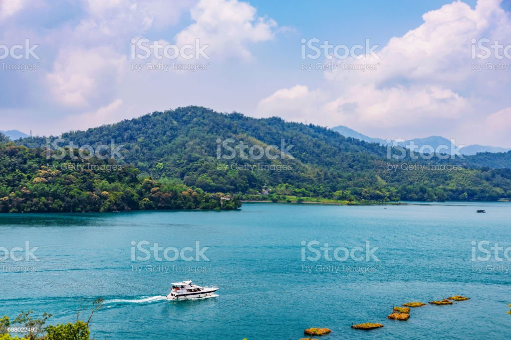View of Sun Moon Lake with a boat stock photo