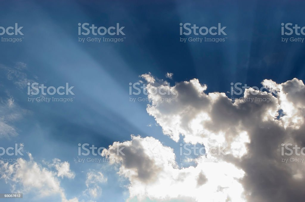 View of sun shining through clouds blue sky royalty-free stock photo