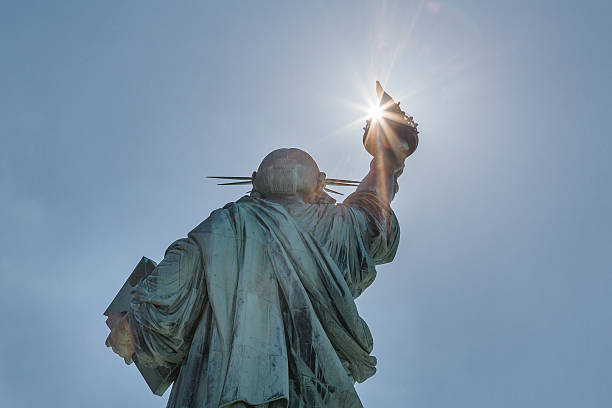 View of sunlight shining through the Statue of Liberty stock photo