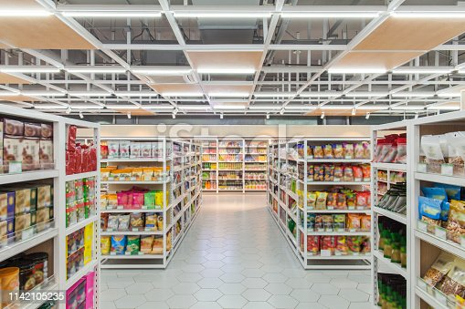 View of supermarket interior snacks section