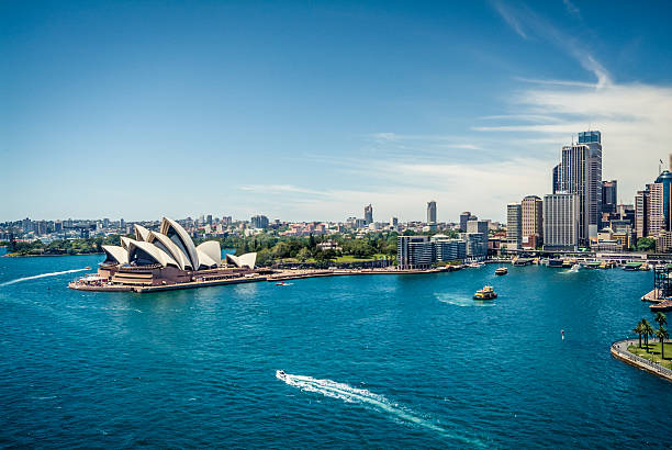 View of Sydney Harbour, Australia Sydney Opera House and Circular quay, ferry terminus, from the harbour bridge. australia stock pictures, royalty-free photos & images
