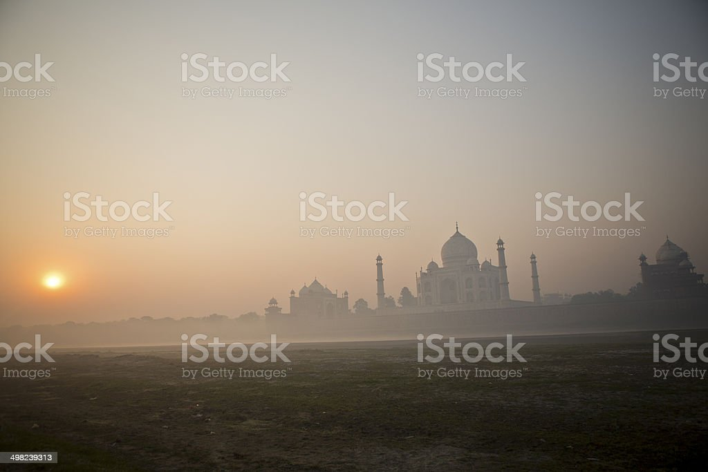 View of Taj Mahal from river side at sunrise. stock photo