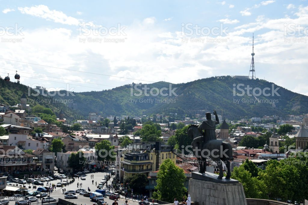 View of Tbilisi including the  equestrian (horse) statue of King Vakhtang Gorgasali, Meidani square, churches, cable cars, and the TV tower stock photo