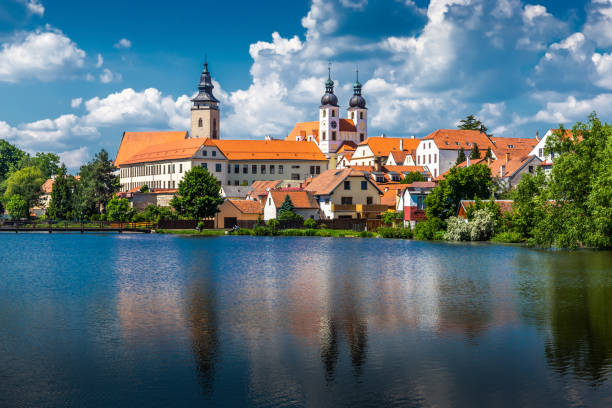 View of Telc across pond with reflections, Unesco world heritage site, South Moravia, Czech Republic. View of Telc across pond with reflections, Unesco world heritage site, South Moravia, Czech Republic. moravia stock pictures, royalty-free photos & images