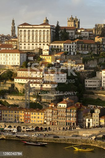Porto, Portugal - November 30, 2019: View of the A Ribeira and the city of Porto at sunset since Luis I bridge lookout, Portugal.