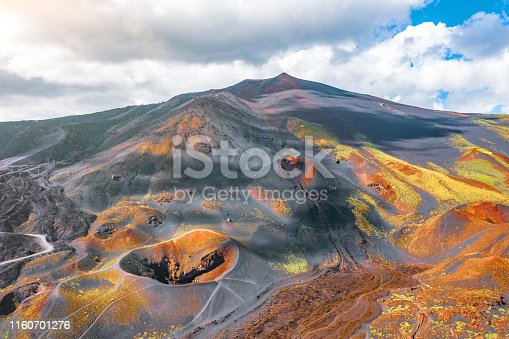 View of the active volcano Etna, extinct craters on the slope, traces of volcanic activity