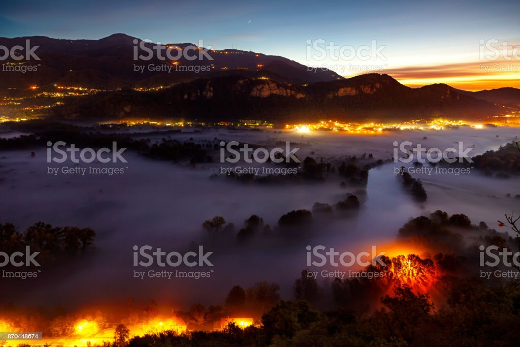 View of the Adda river during a foggy morning, Airuno, Italy stock photo