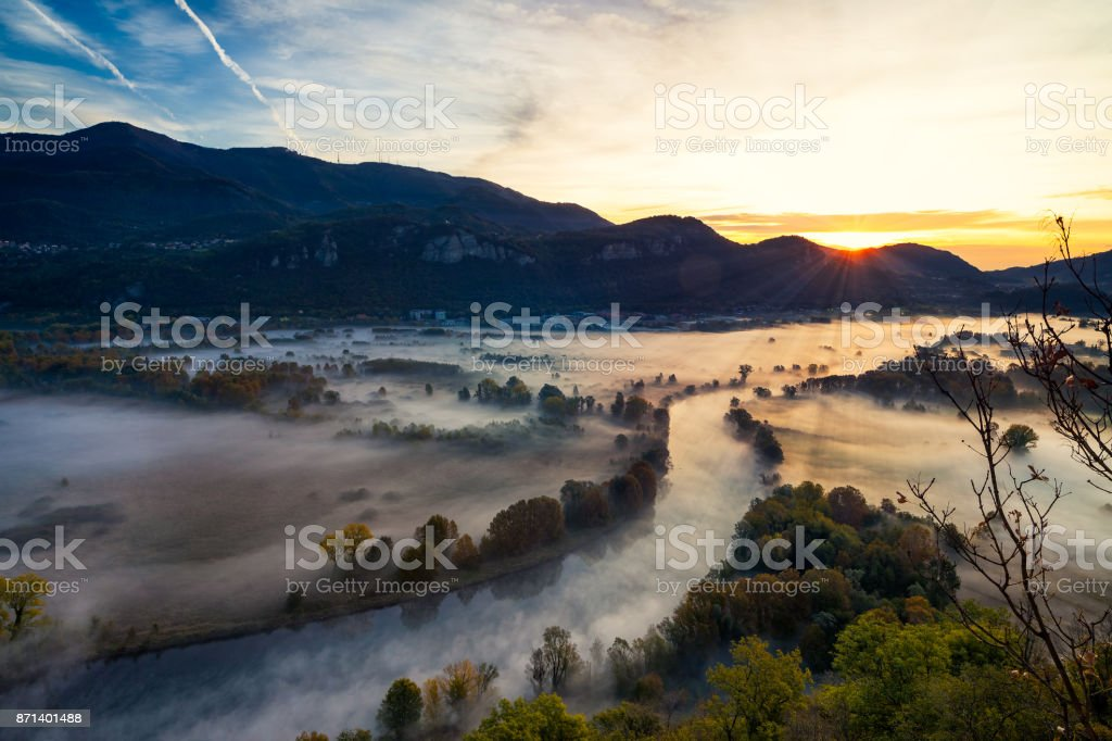 View of the Adda river valley during a foggy morning, Airuno, Italy stock photo
