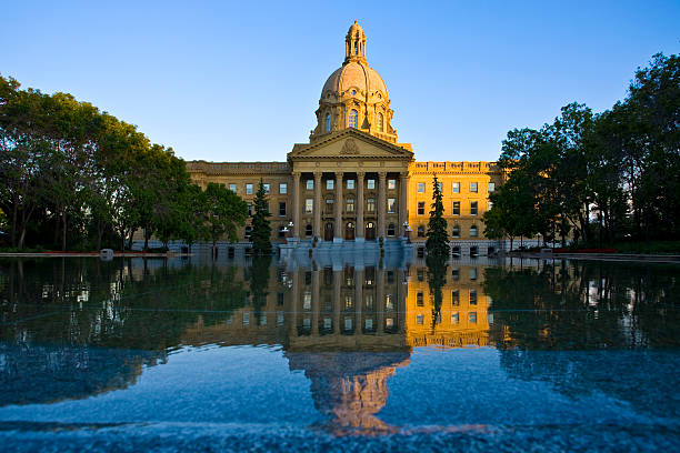 View of the Alberta Legislature Building across the water Alberta Legislature building. alberta stock pictures, royalty-free photos & images