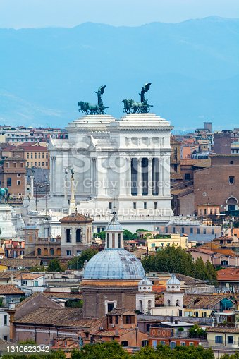 Rome, Italy - Oct 05, 2018: View of the Altare della Patria framed by roofs in Rome