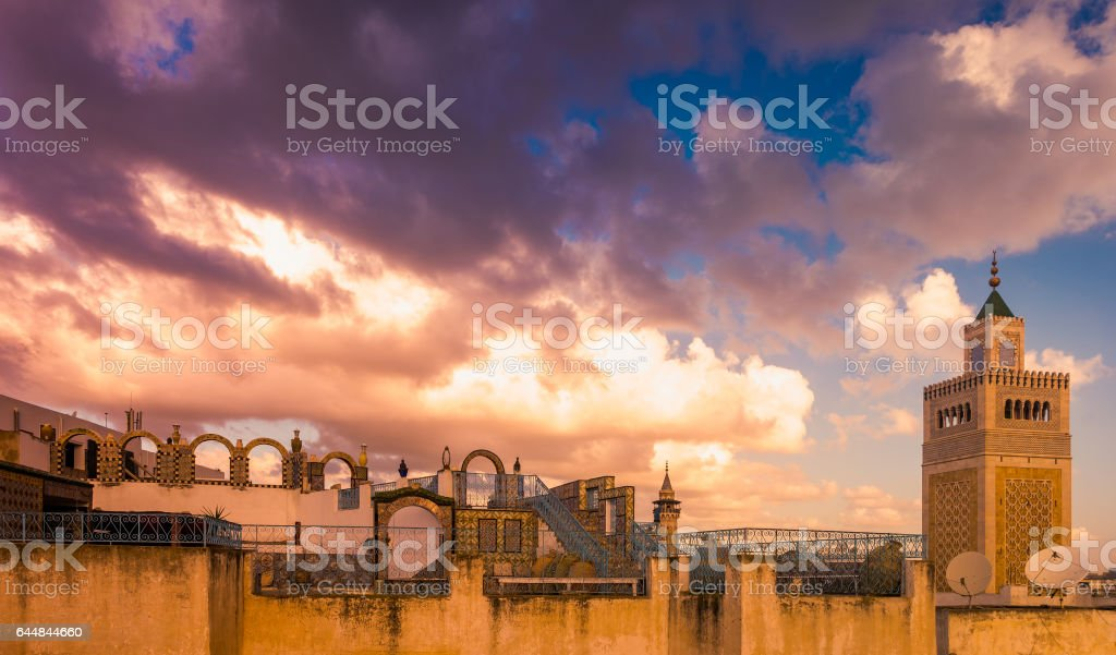View of the Al-Zaytuna Mosque and the skyline of Tunis at dawn stock photo