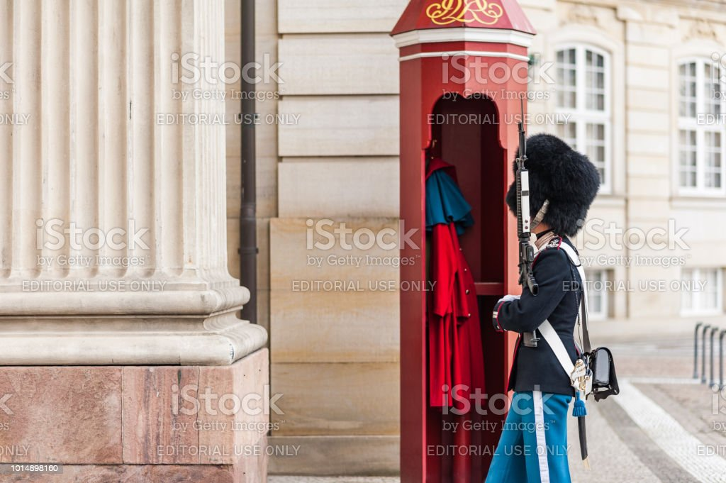 View of the Amalienborg Square with a royal guard (Royal Life Guard) standing in front of the Levetzau's Palace. stock photo