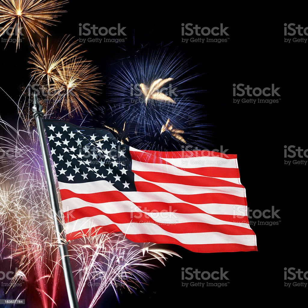 View of the American flag in front of colorful fireworks royalty-free stock photo