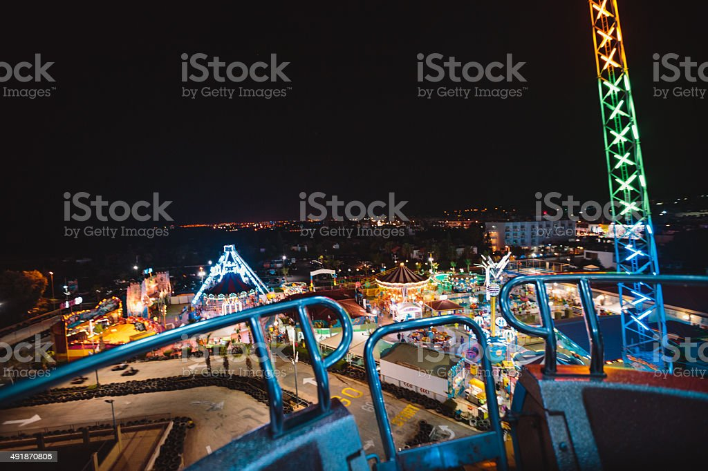 view of the amusement park at night stock photo
