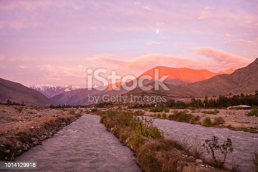 View of the Andes mountain range as seen from Vicuña in the Elqui Valley during the sunset sunrise in Chile