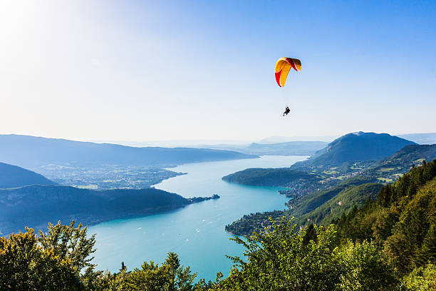 View of the Annecy lake from  Col du Forclaz View of the Annecy lake from  Col du Forclaz paragliding stock pictures, royalty-free photos & images