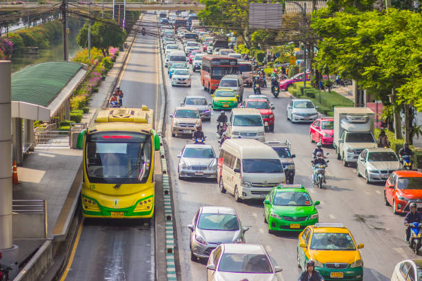 Bangkok, Thailand - February 21, 2017: View of The Bangkok BRT, bus rapid transit system in Bangkok,Thailand. The buses run on dedicated bus lanes in the center of the road to avoid typical curb-side delays. Bangkok, Thailand - February 21, 2017: View of The Bangkok BRT, bus rapid transit system in Bangkok,Thailand. The buses run on dedicated bus lanes in the center of the road to avoid typical curb-side delays. bus rapid transit stock pictures, royalty-free photos & images