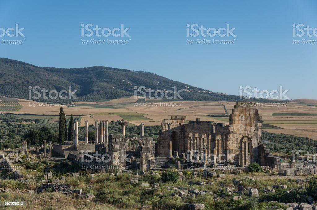 View of the Basilica and Capitoline Temple, archaeological Site of Volubilis, ancient Roman empire city, Unesco World Heritage Site, located in Morocco near Meknes stock photo