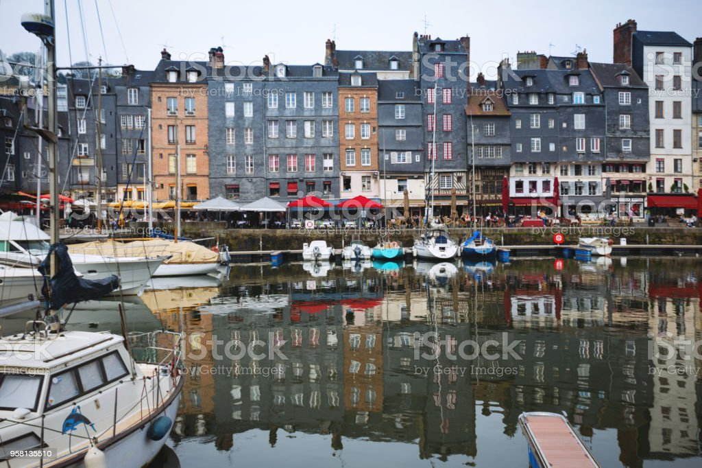 view of the bay and the embankment  in the famous French city Honfleur. Normandy, France stock photo