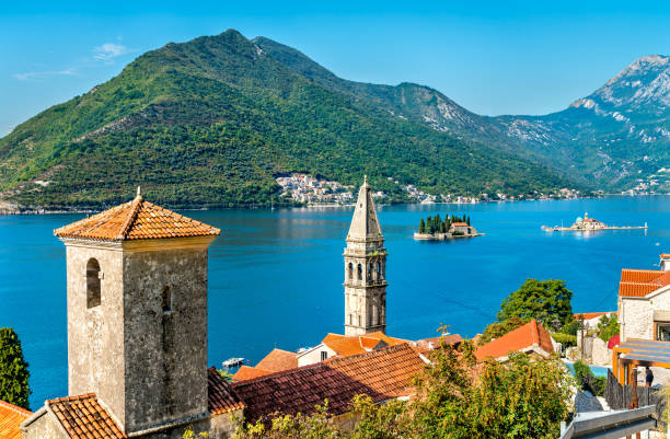 view of the bay of kotor with two small islands and bell towers in perast, montenegro - unesco foto e immagini stock