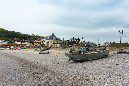 Colored fishing boats on the beach of Etretat, Normandy, France