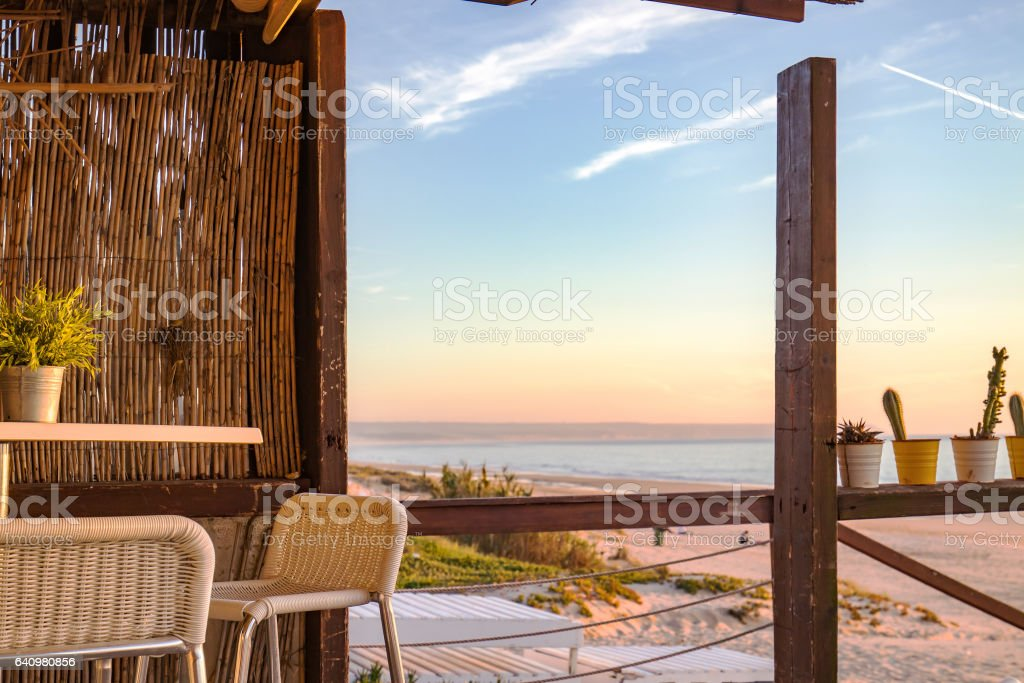 view of the beach during sunset from the bar stock photo