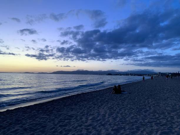 View of the beach during sunset stock photo