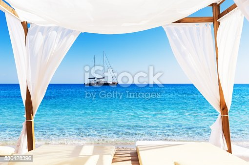 istock View of the beautiful beach through a Balinese bed 530428396