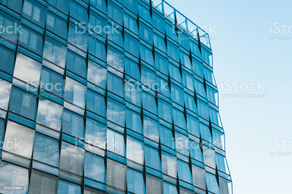 View of the beautiful modern futuristic building. Business concept of successful industrial architecture. stock photo